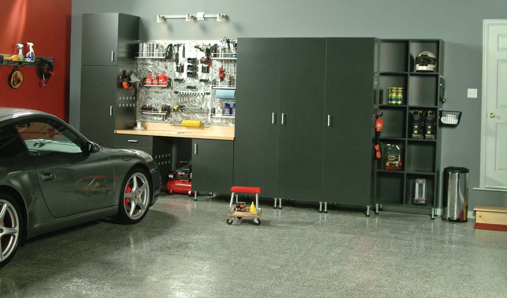 Mechanic garage with sportscar parked and items organized on shelves and workspace