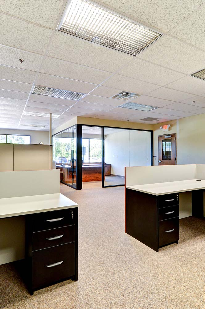 Custom commercial office design with two toned desks and cabinets