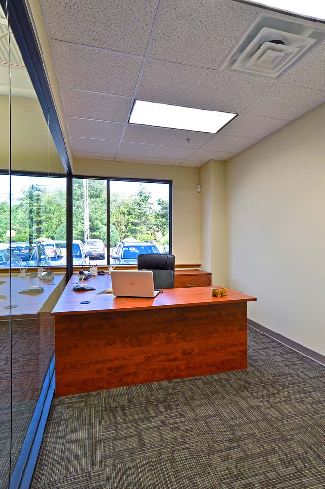 Custom built office furniture with open office design