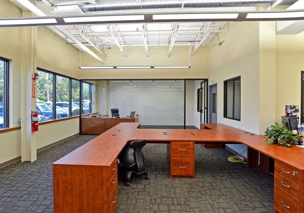 Custom commercial office design with wraparound desks