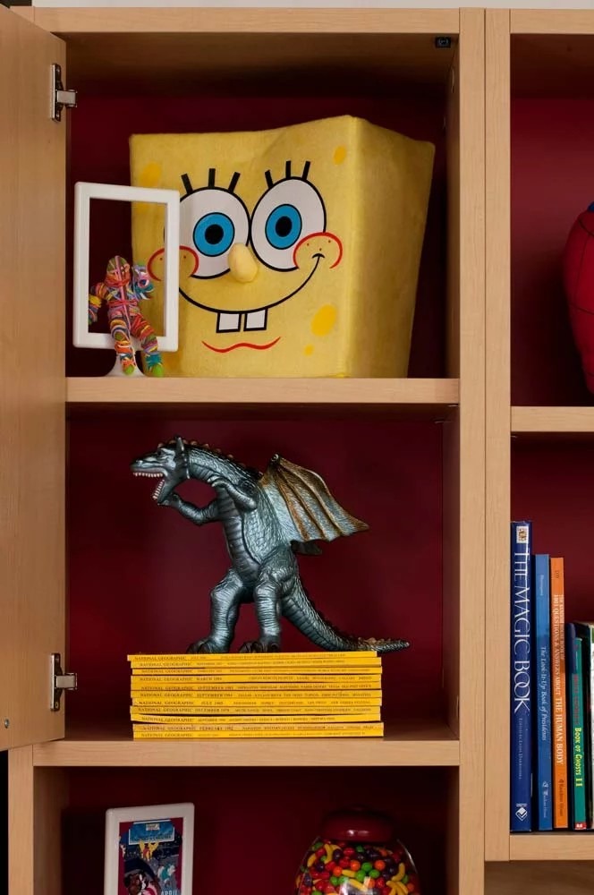 Custom furniture unit with cubbies filled with toys and books
