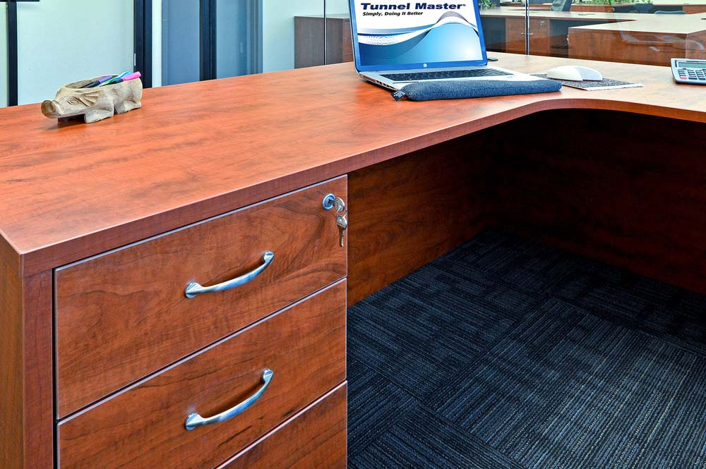 Wraparound desk space with locked bottom cabinets