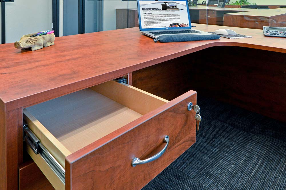 Custom built doverail plywood drawer open below desk space