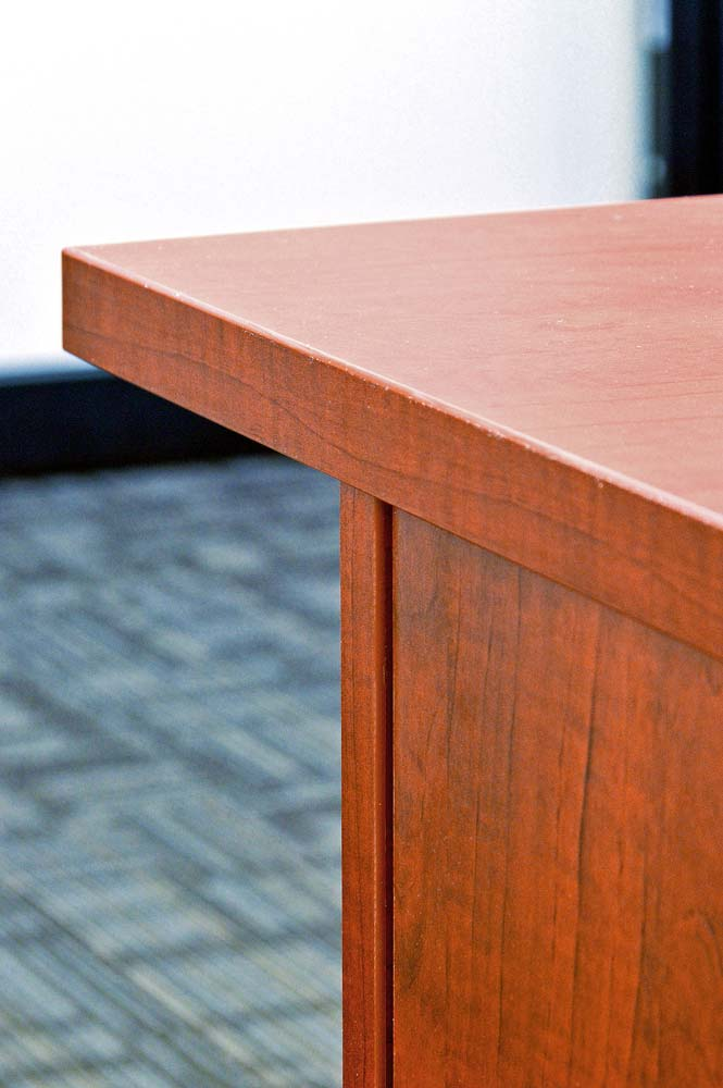 Desk with two-millimeter thick edge banding