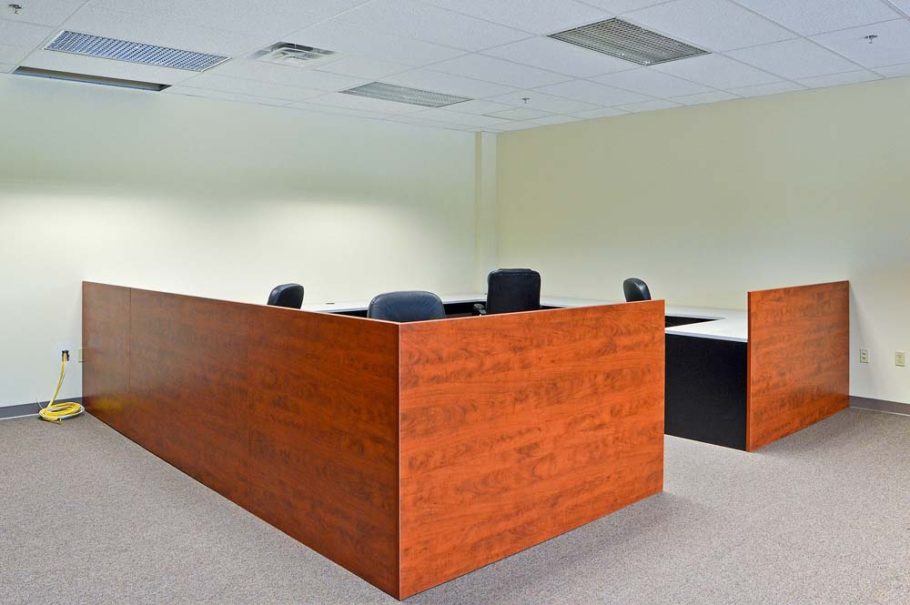 Custom built commercial office reception area with coordinated workspaces