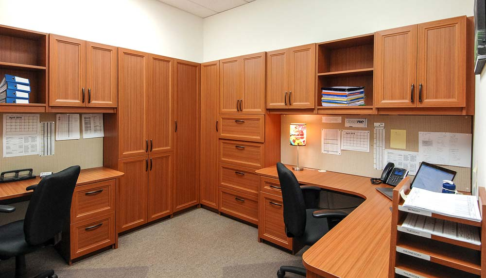 Custom built commercial office furniture with tall cabinets and two workspaces