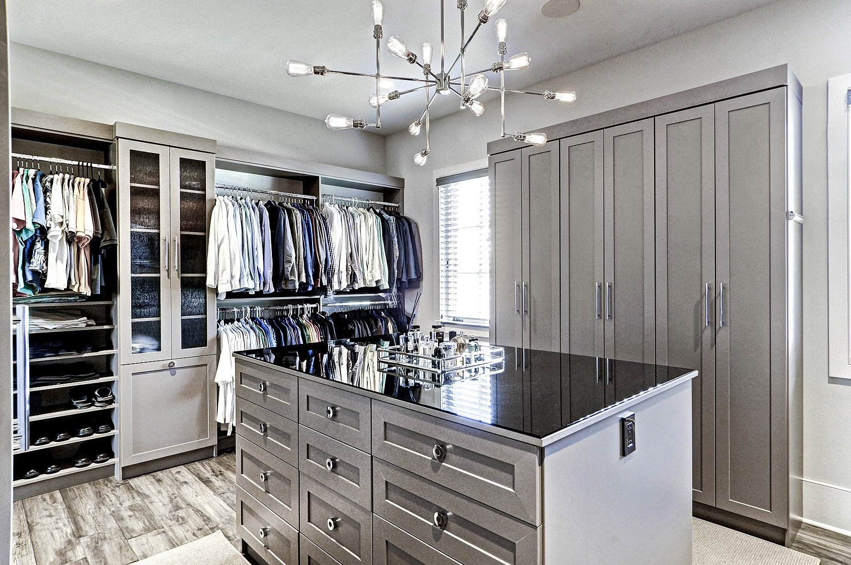 Walk-in closet with center island and organized shelves and cabinets