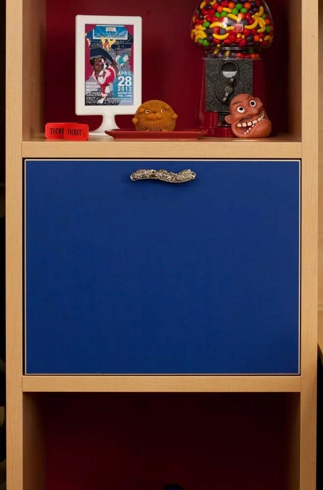 Decorative hardware on cubbie door of custom furniture piece