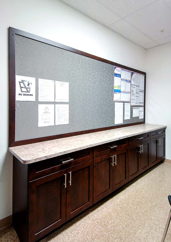 Custom built office cabinet with countertop and tack board