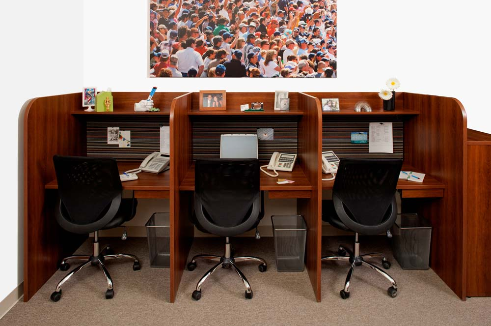 Custom built call center furniture with 3 workspaces