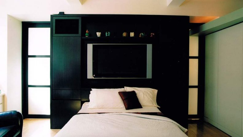 Black custom cabinet with built in zoom room bed open