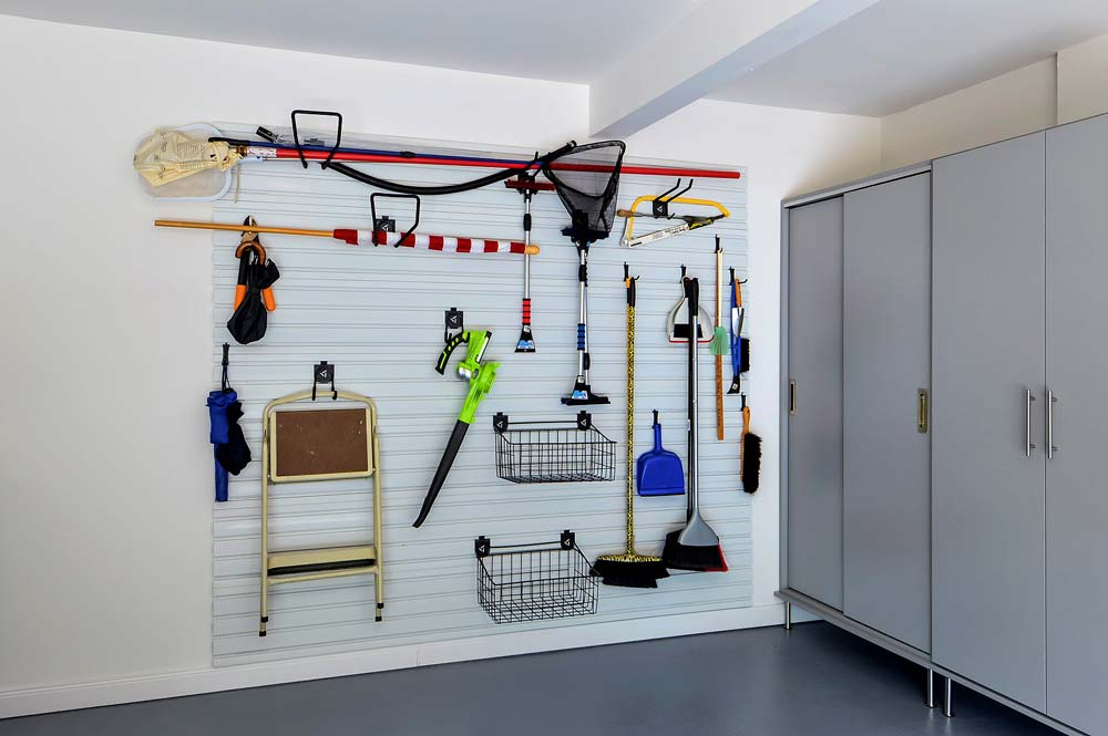 Outdoor tools and equipment organized on wall system