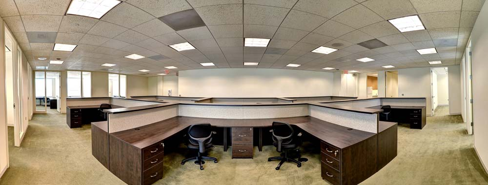 Commercial office design with large workspaces and custom built cubicles