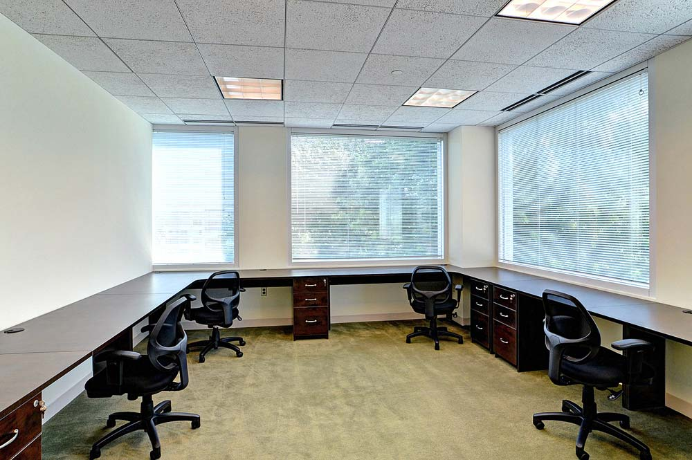 Custom commercial office design with wraparound workspaces