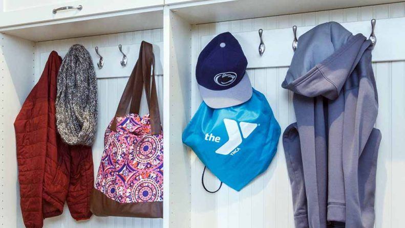 Mudroom hooks with bags and jackets neatly organized