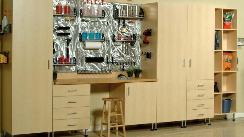 Decluttered garage space with items stored and organized in cabinets