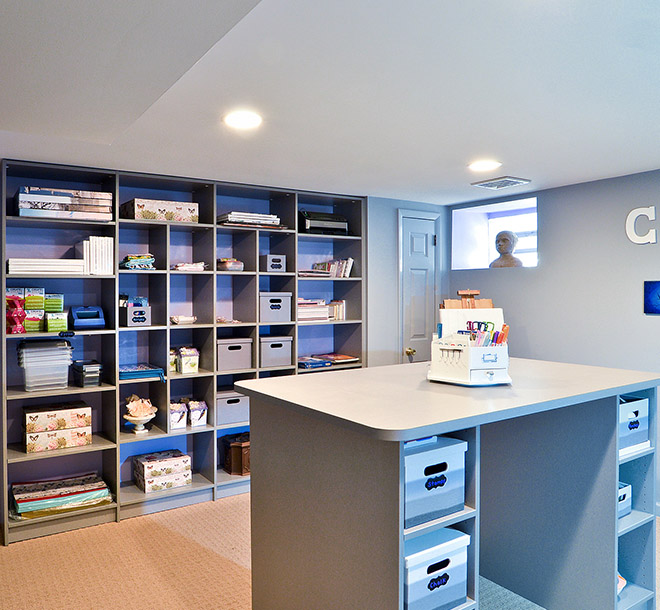Hobby room with art and craft supplies organized on shelves