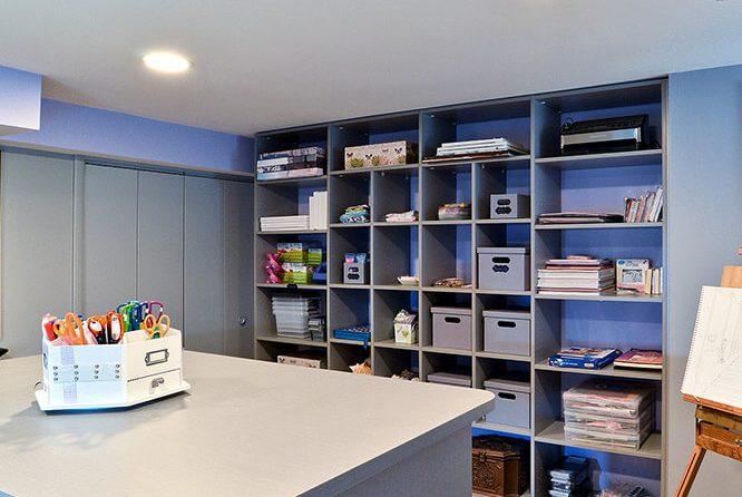 Craft and hobby room with easel and cubbies organizing art supplies