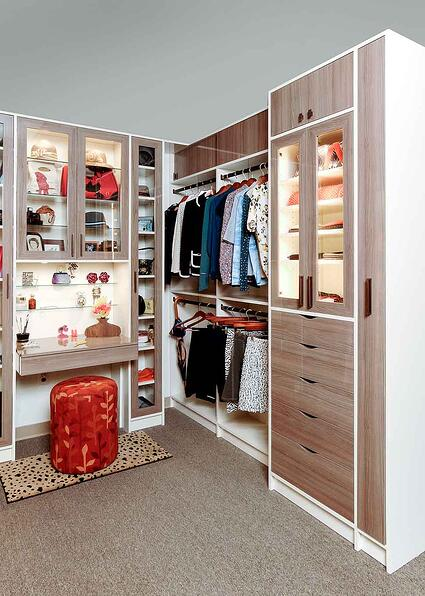 High Gloss Finished Closet Organized With Various Wardrobe Items and Accessories