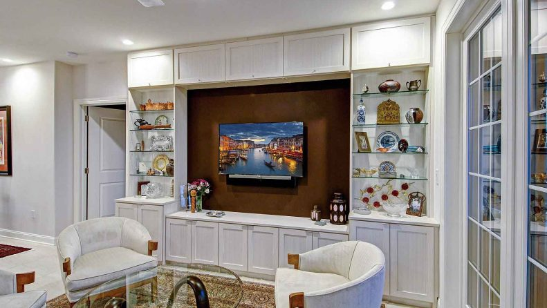 Custom media center and wall unit with cabinets and entertainment center