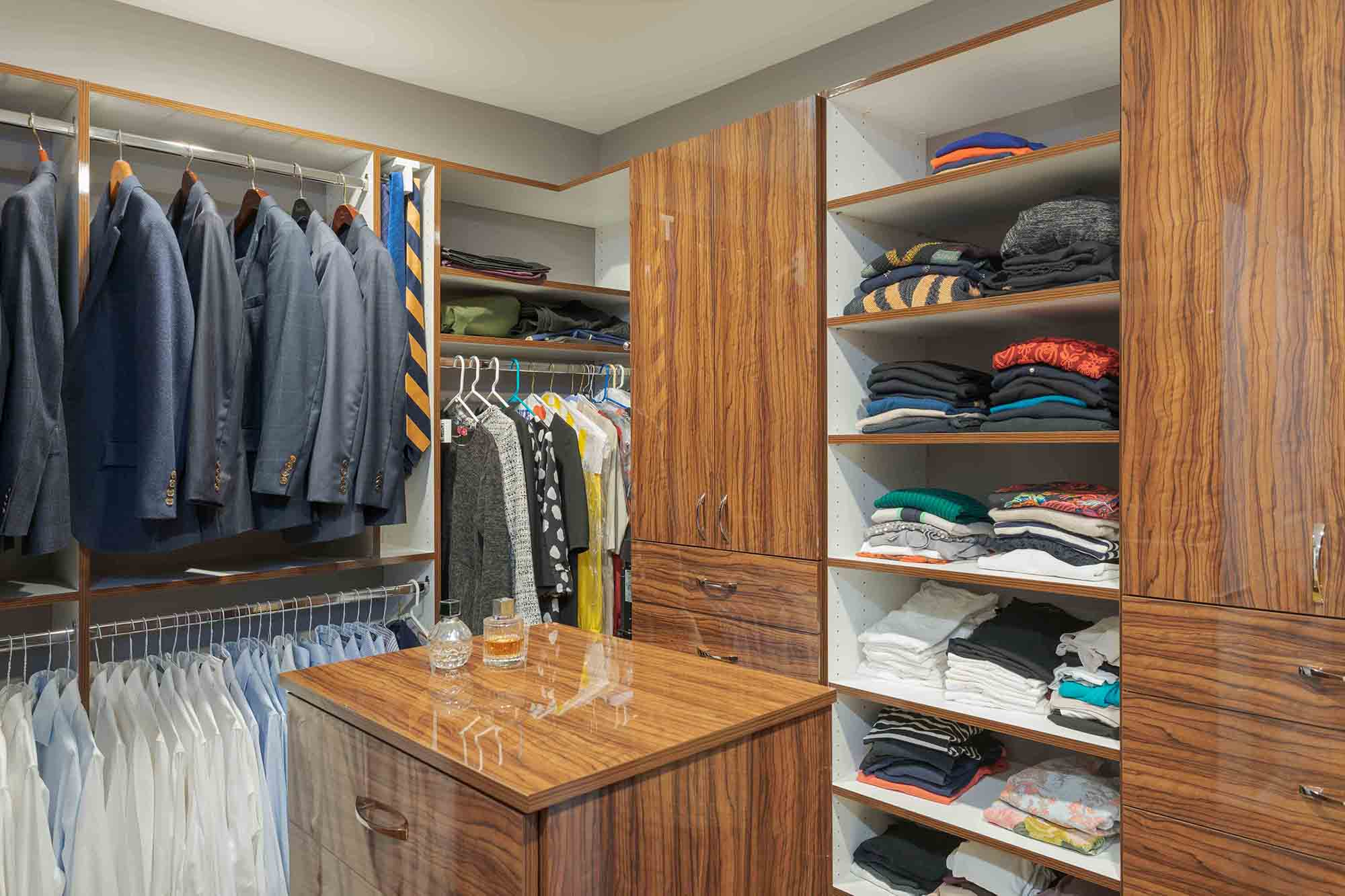 Organized jackets and pants in walk-in closet