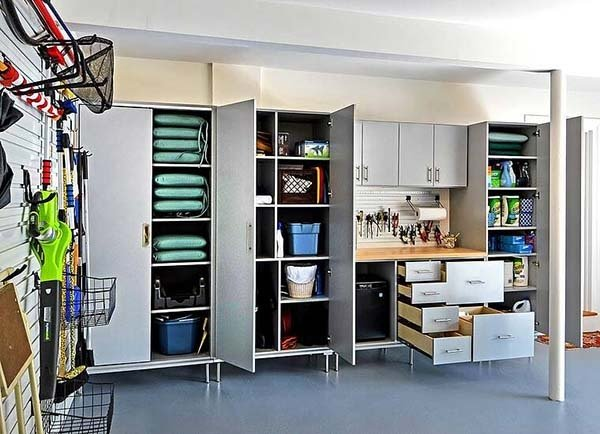 Outdoor equipment organized in garage cabinets