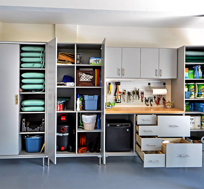 Garage cabinet with outdoor furniture and gear organized