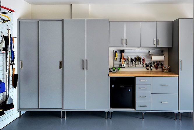 Garage cabinets and wall system organizing outdoor items