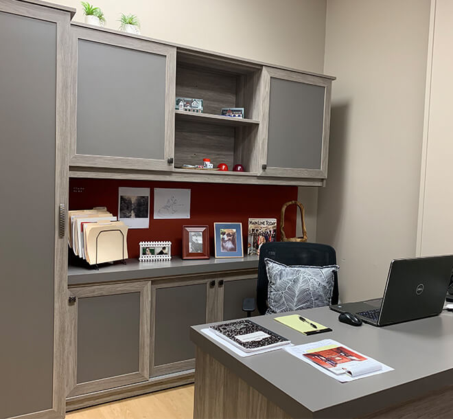 Organized home office space with desk and matching cabinets