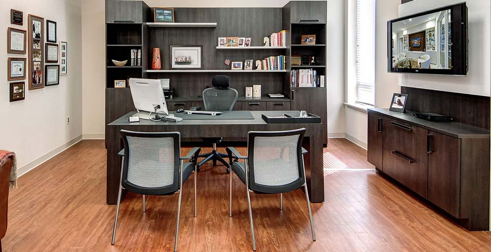 Modern home office design with workstation and custom built cabinets