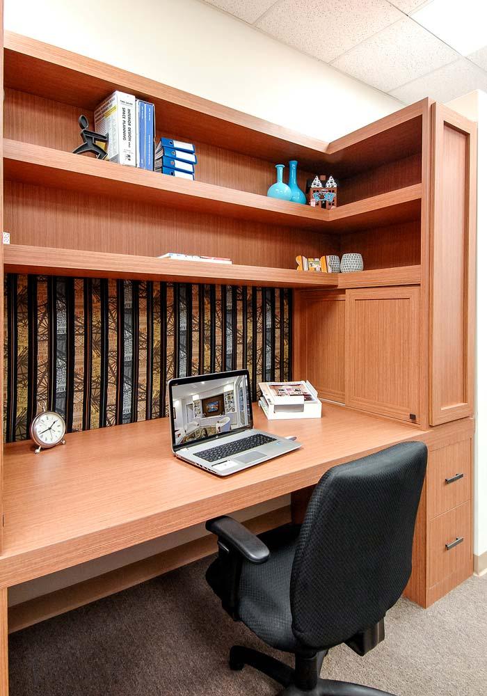 Desk workspace with additional storage concealed behind sliding doors
