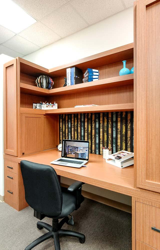 Custom built shelves above desk workspace