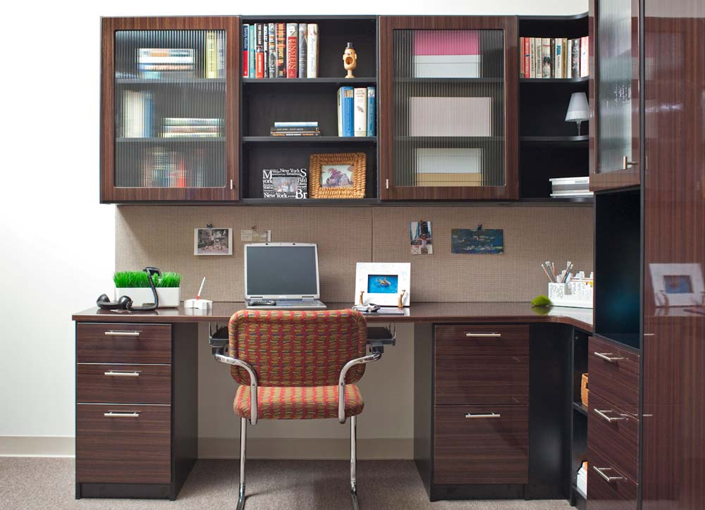 Custom home office design with drawers and angled shelves