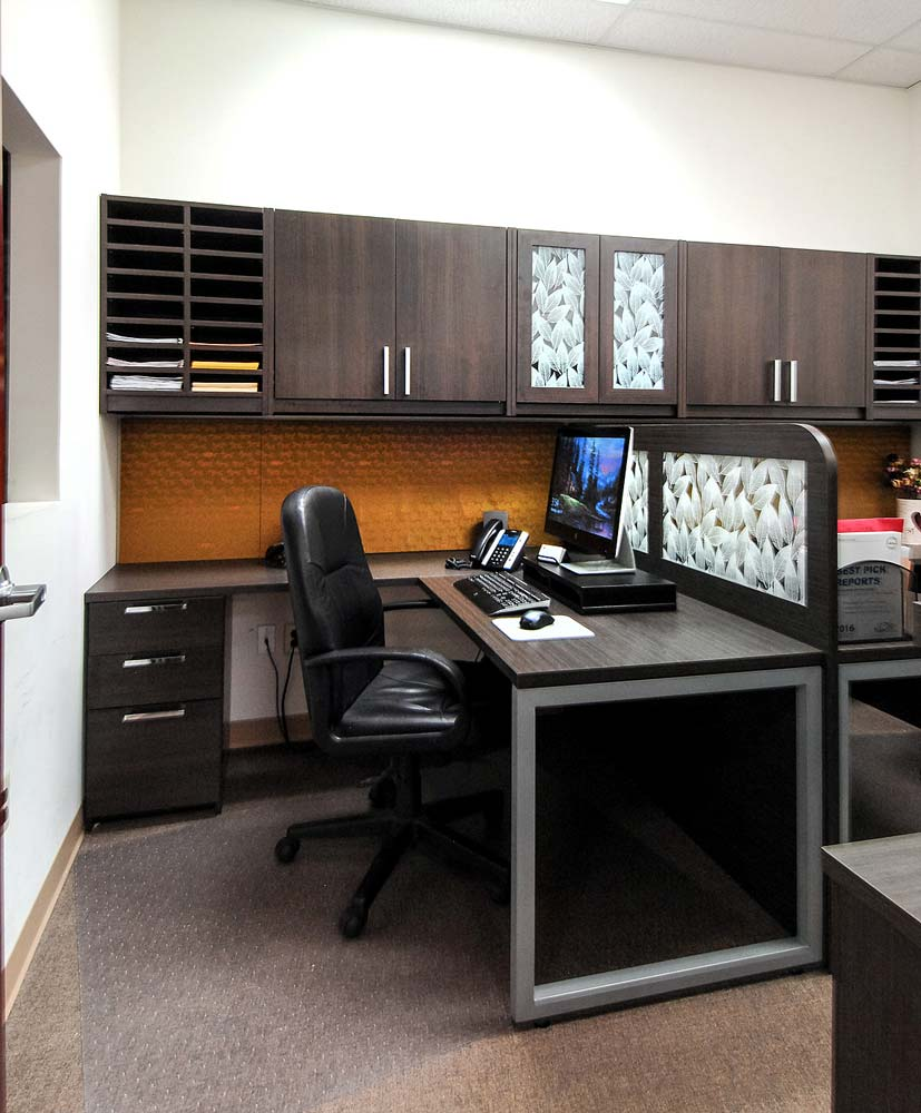 Two workspaces with beautiful wood cabinetry separated by glass inserts