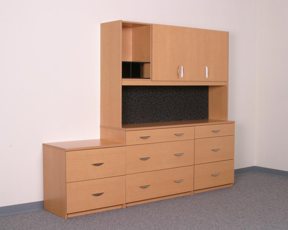 Office workspace with empty wood cabinets and drawers