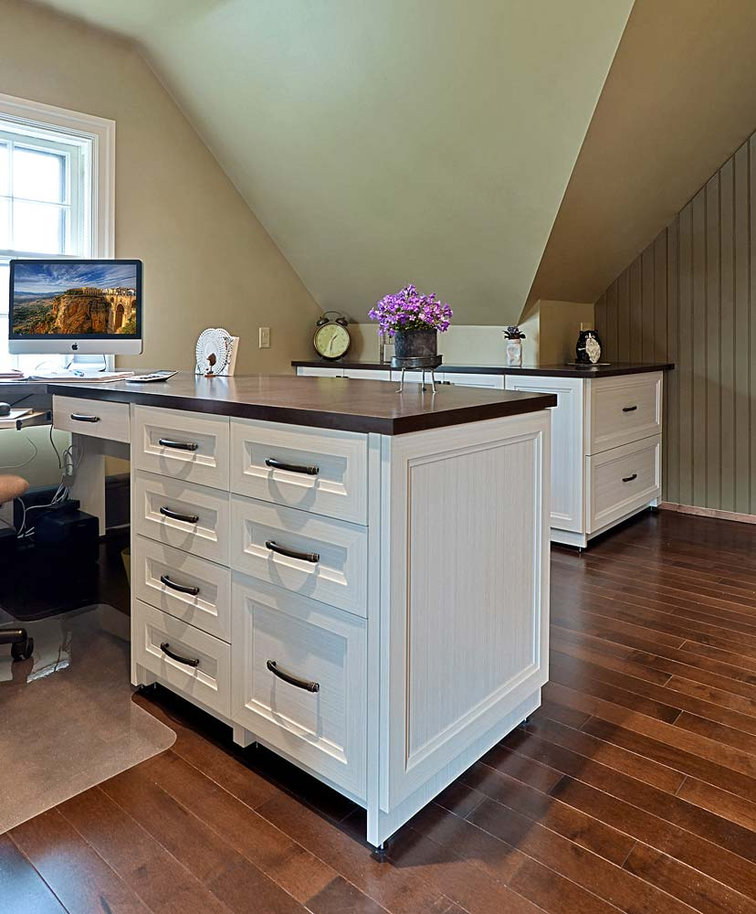 Home office interior idea with wrap around desk area and additional drawers for storage