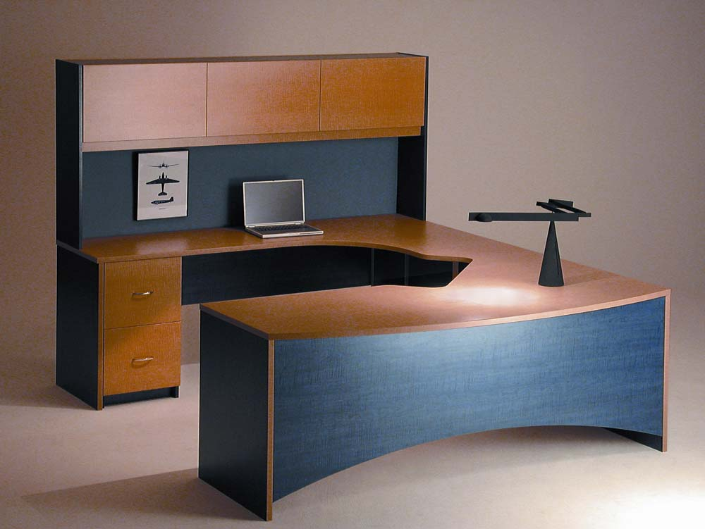 Custom home office design with wraparound desk and cabinets