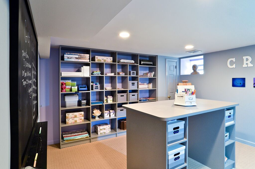 Craft and hobby room with art supplies organized on shelves