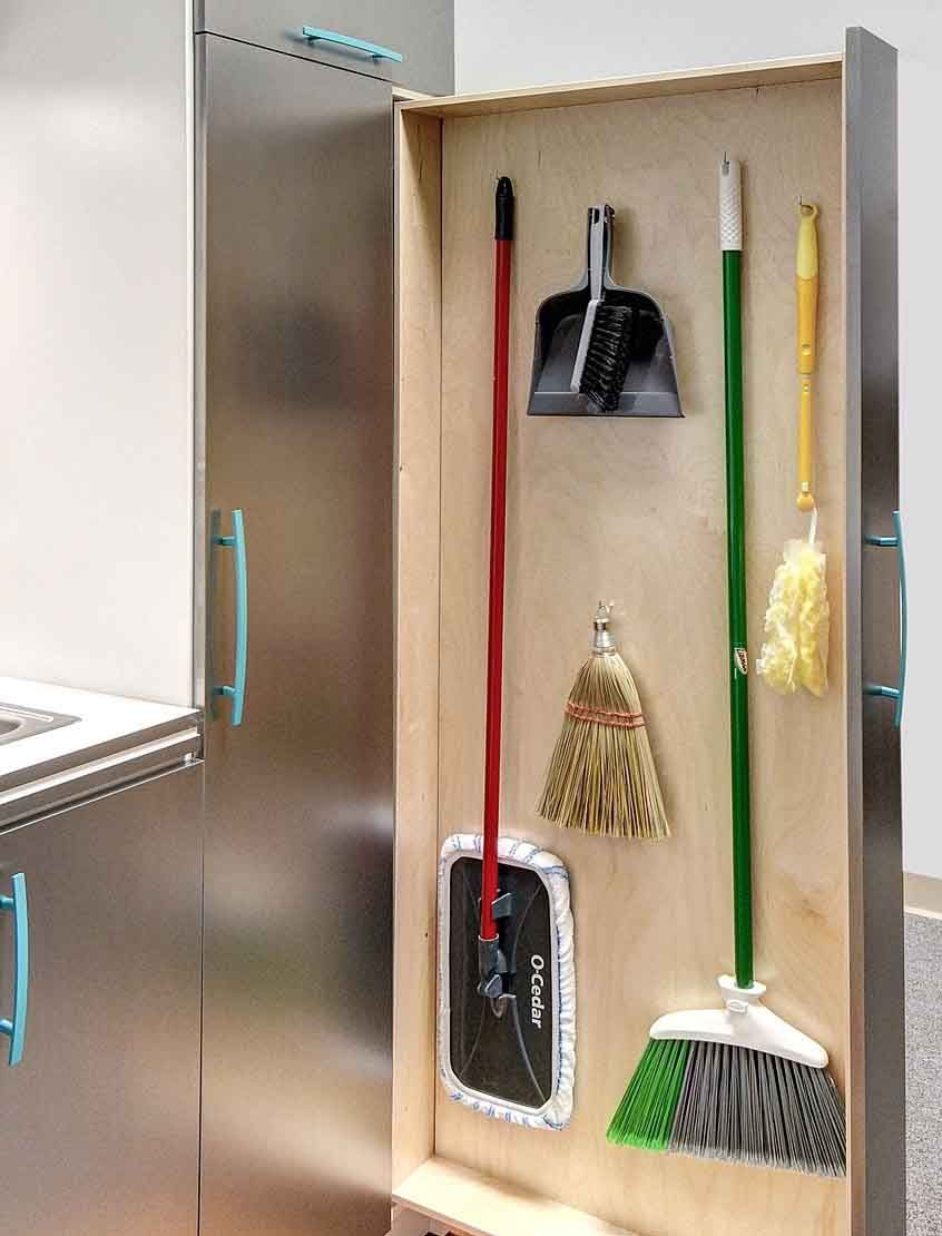 Laundry room design with verticial sliding doors