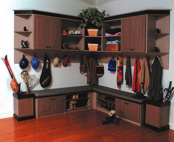 Mudroom with sports gear, coats, and bags neatly hung on hooks