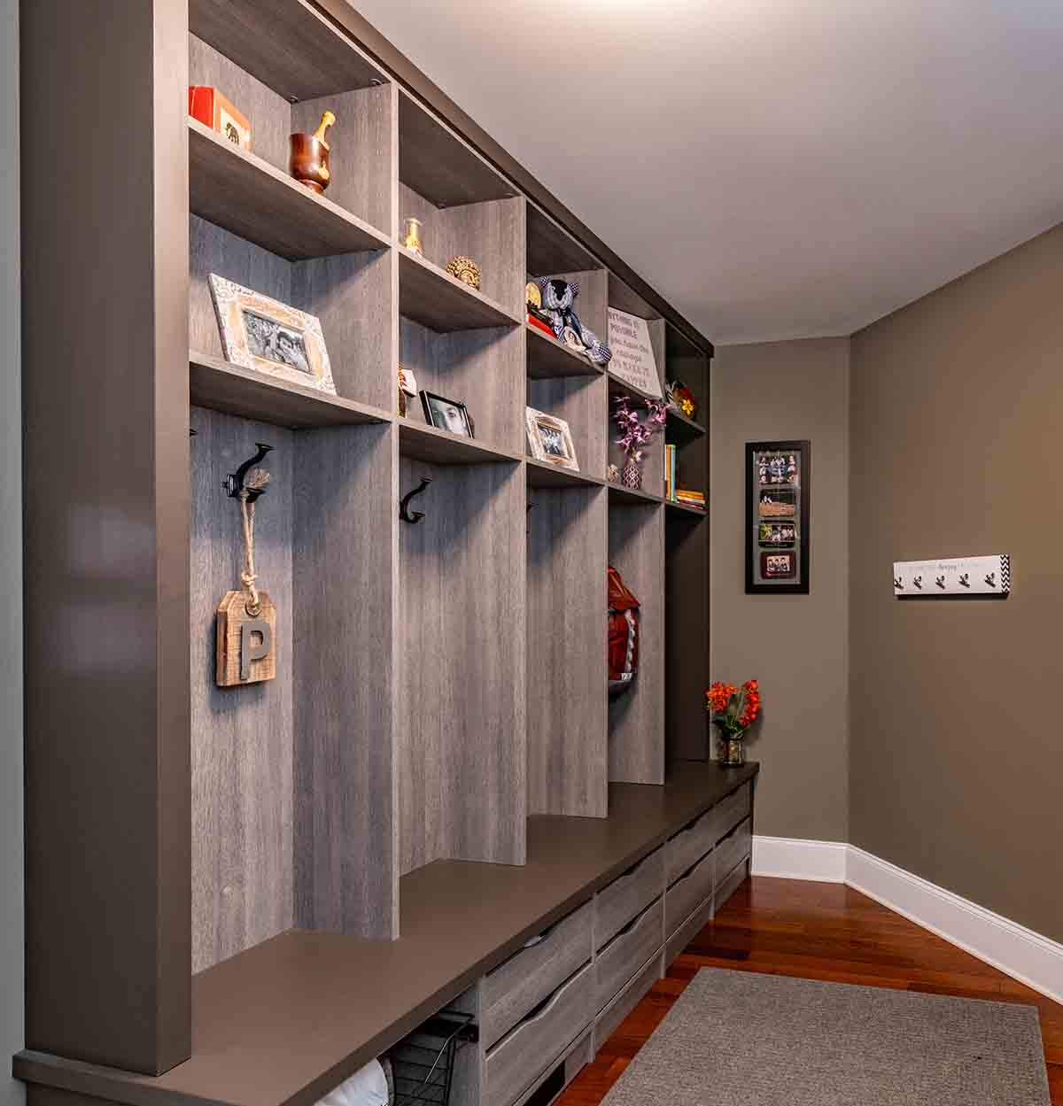 Mudroom with cubbies and underneath storage compartments