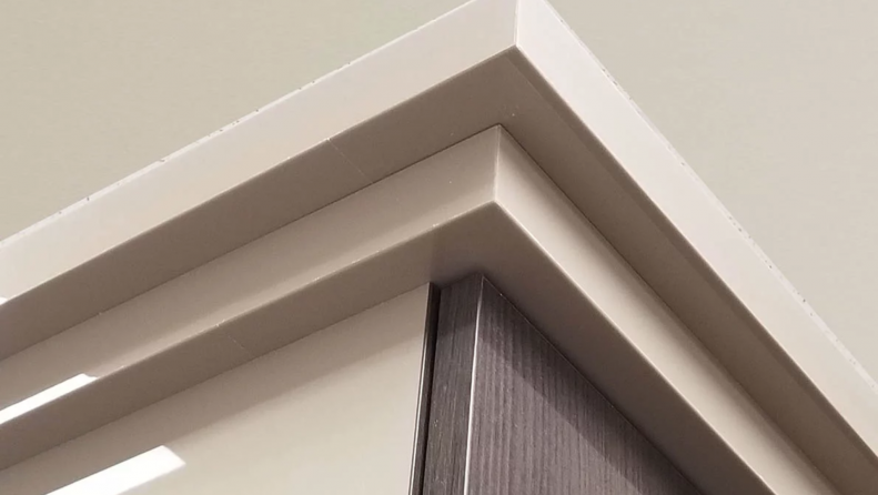Crown molding on the top of a wall bed unit