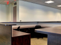 Custom office design with custom cubicles and multiple work stations
