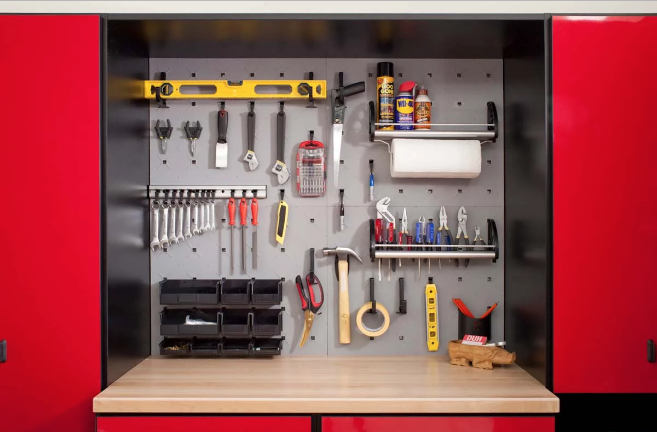 Wall mount system storing a variety of tools and supplies