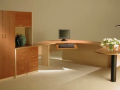Home office design with wraparound workstation with side cabinets for additional storage