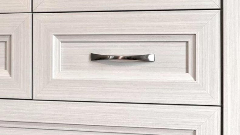 Custom built wardrobe drawer with decorative hardware handles