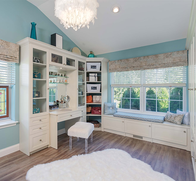 Walk-in closet solution with sitting area and vanity