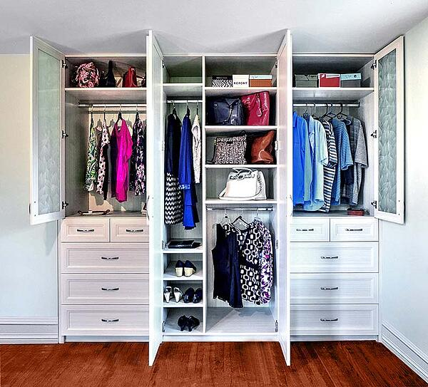 waardrobe closet with clothes organized and stored in drawers, shelves and hangers