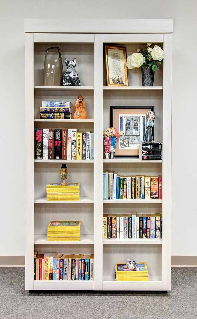 Pivoting bookcase with disguised doors and stored vertical Murphy Bed