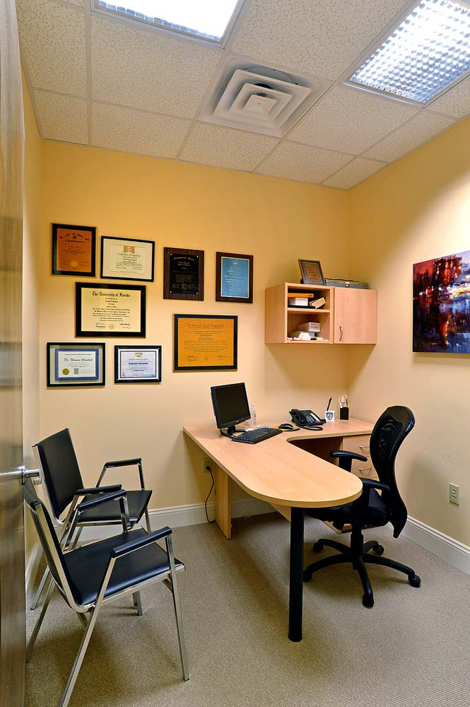 Dental office with custom wrap around desk furniture piece